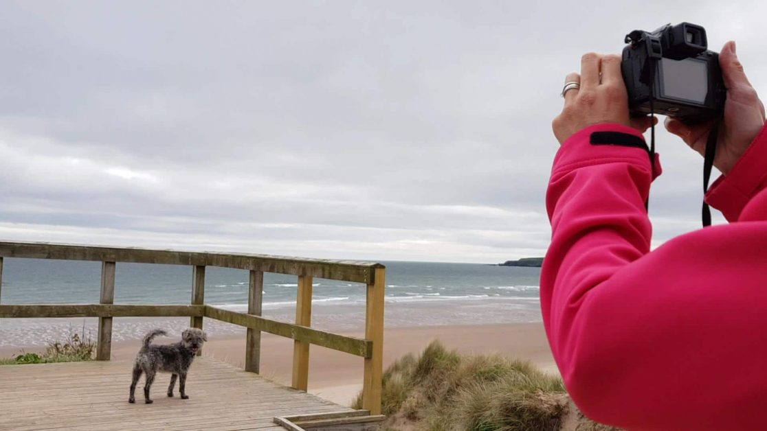 Sam posing at Lunan Bay
